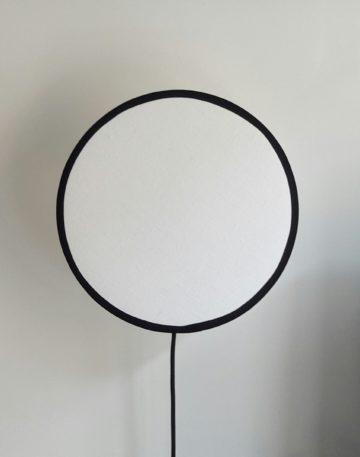 magasin luminaire lyon lampe tam tam tambour applique murale abat jour rond tissu lin blanc noir