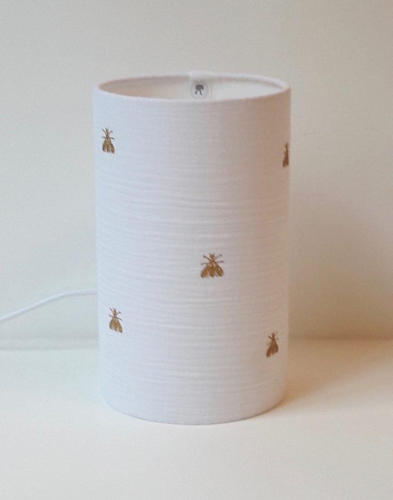 magasin luminaire lyon lampe totem tube chevet double gaze coton blanche decoration interieur chambre abeilles pailletees or dorees